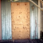 many of the doors and most of the windows were boarded up like this