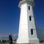 photographing Peggy's Cove lighthouse, photo by Tim